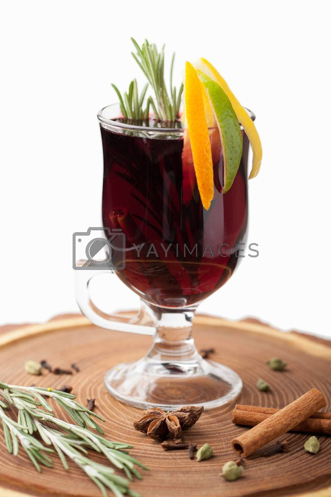 Traditional winter sweet hot alcohol drinks mulled red wine  glintwine with orange, spices, cinnamon, rosemary, anise served on wooden board