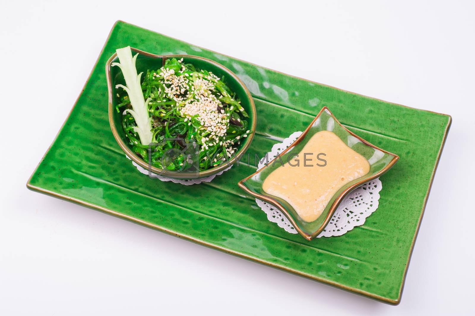 chuka salad with nut sause isolated on white background