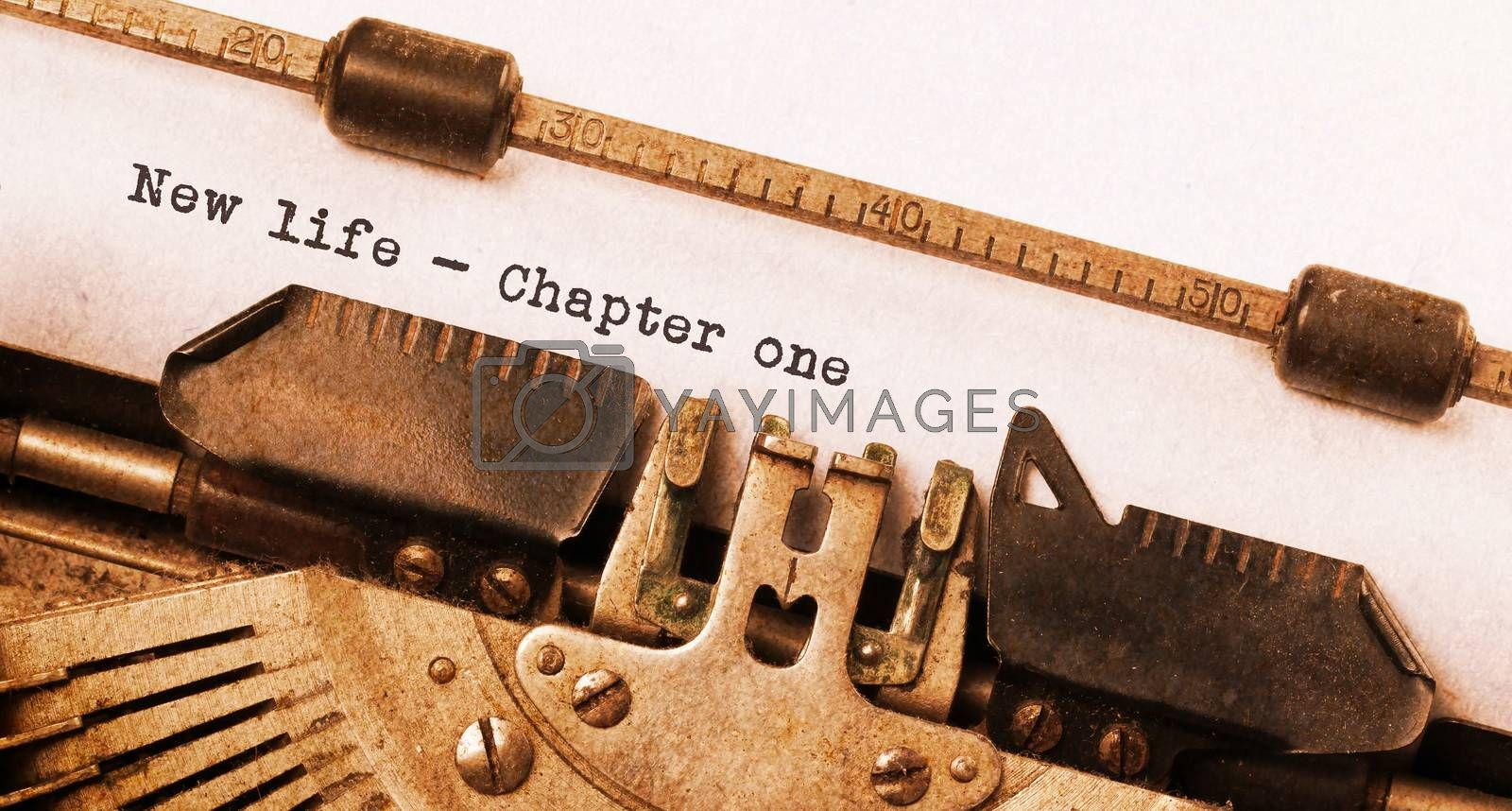 Vintage typewriter, old rusty, warm yellow filter, new life chapter 1