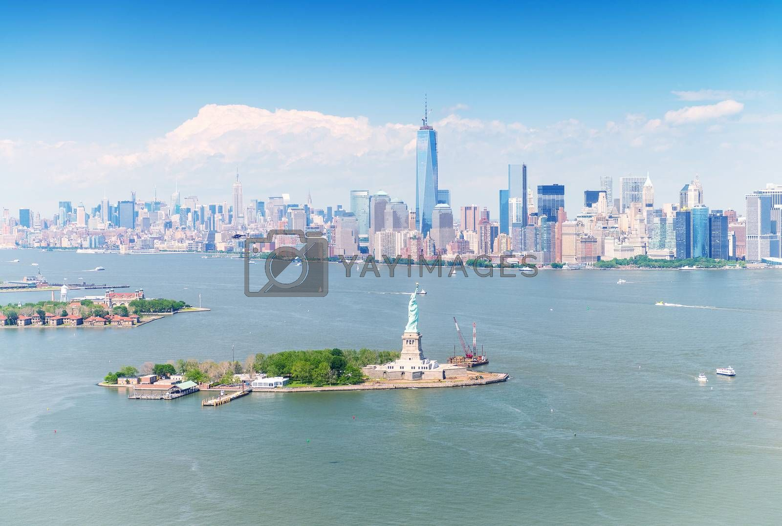 Stunning Manhattan aerial panorama with Statue of Liberty on foreground.