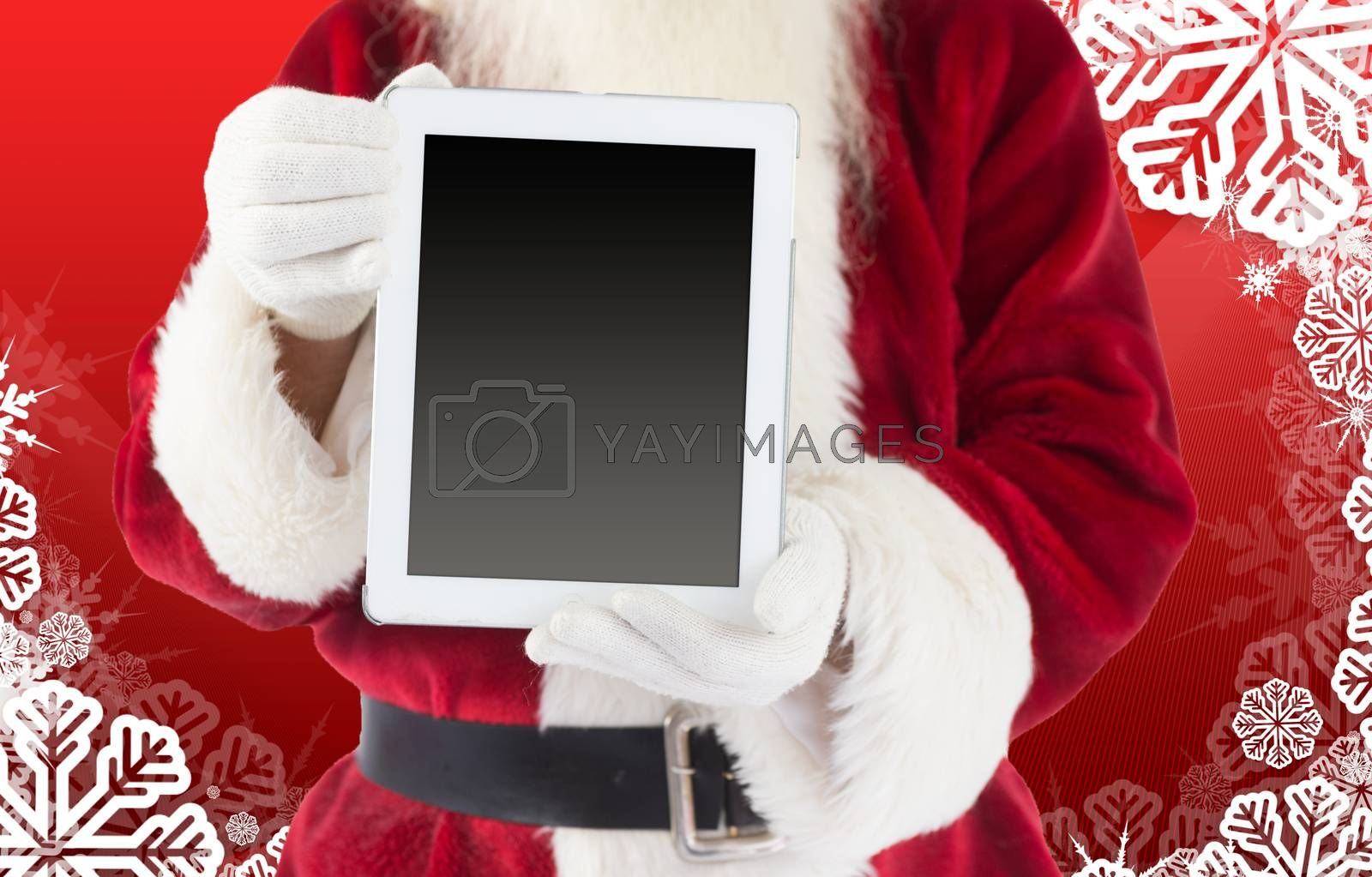 Composite image of santa claus showing tablet pc by Wavebreakmedia