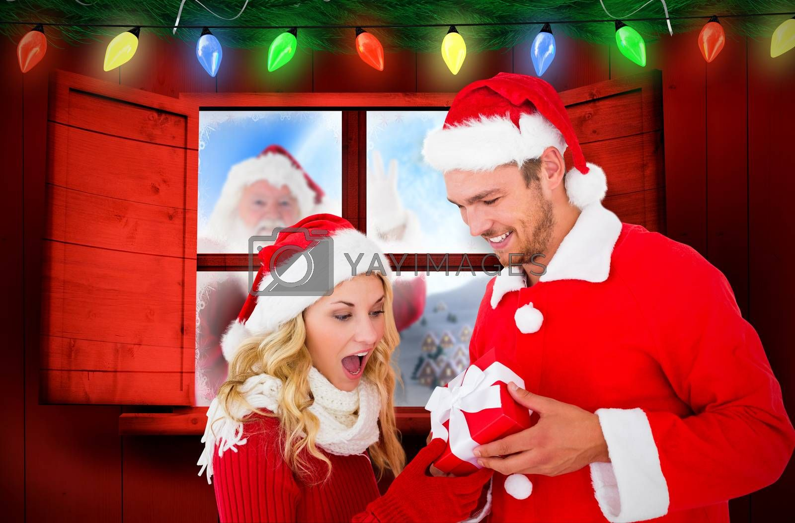 Young festive couple against fir branch christmas decoration garland
