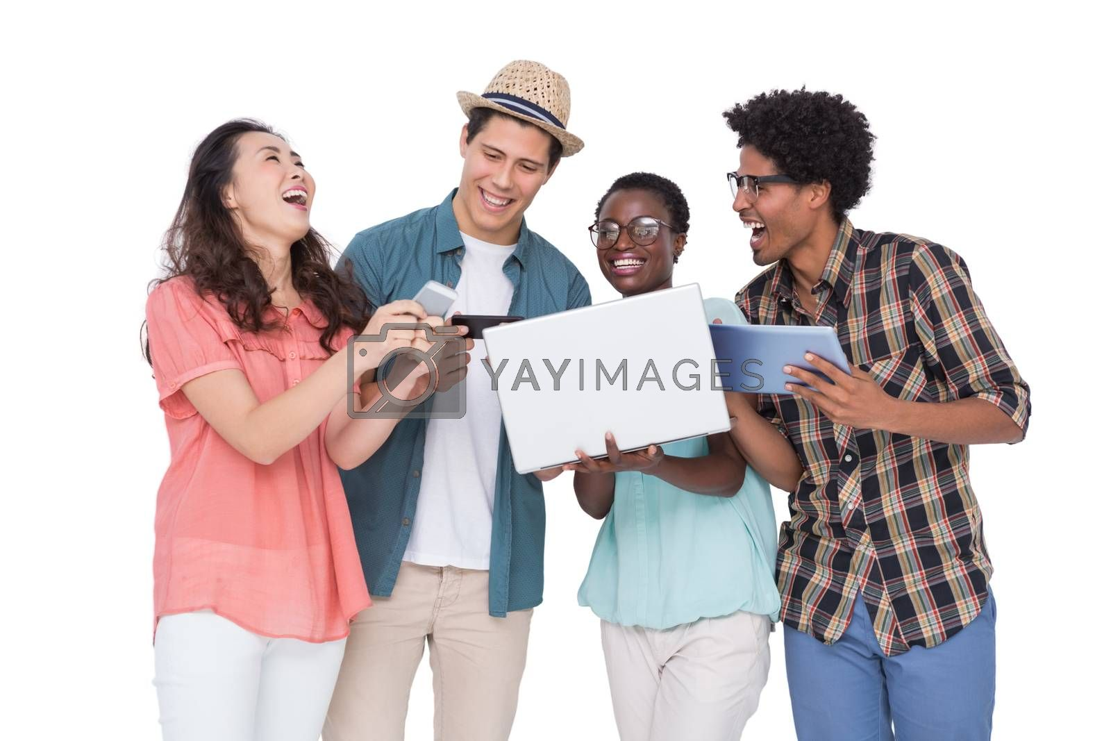 Stylish friends using their technology on white background