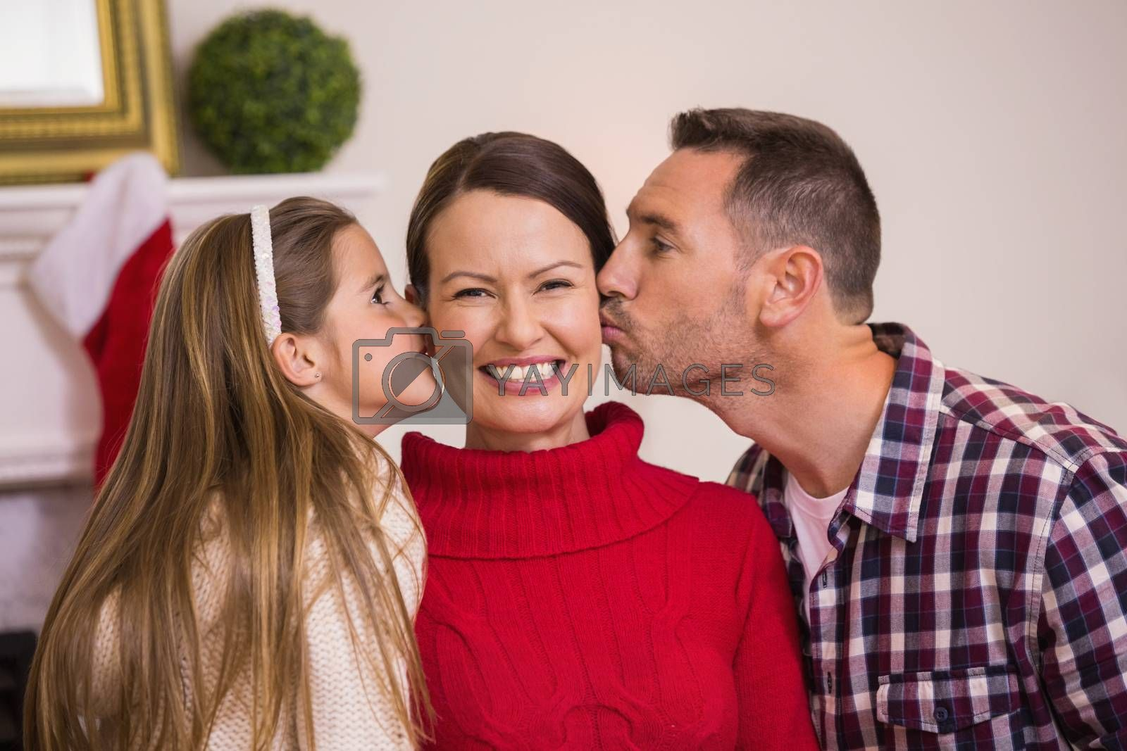 Daughter with her father kissing her mother by Wavebreakmedia