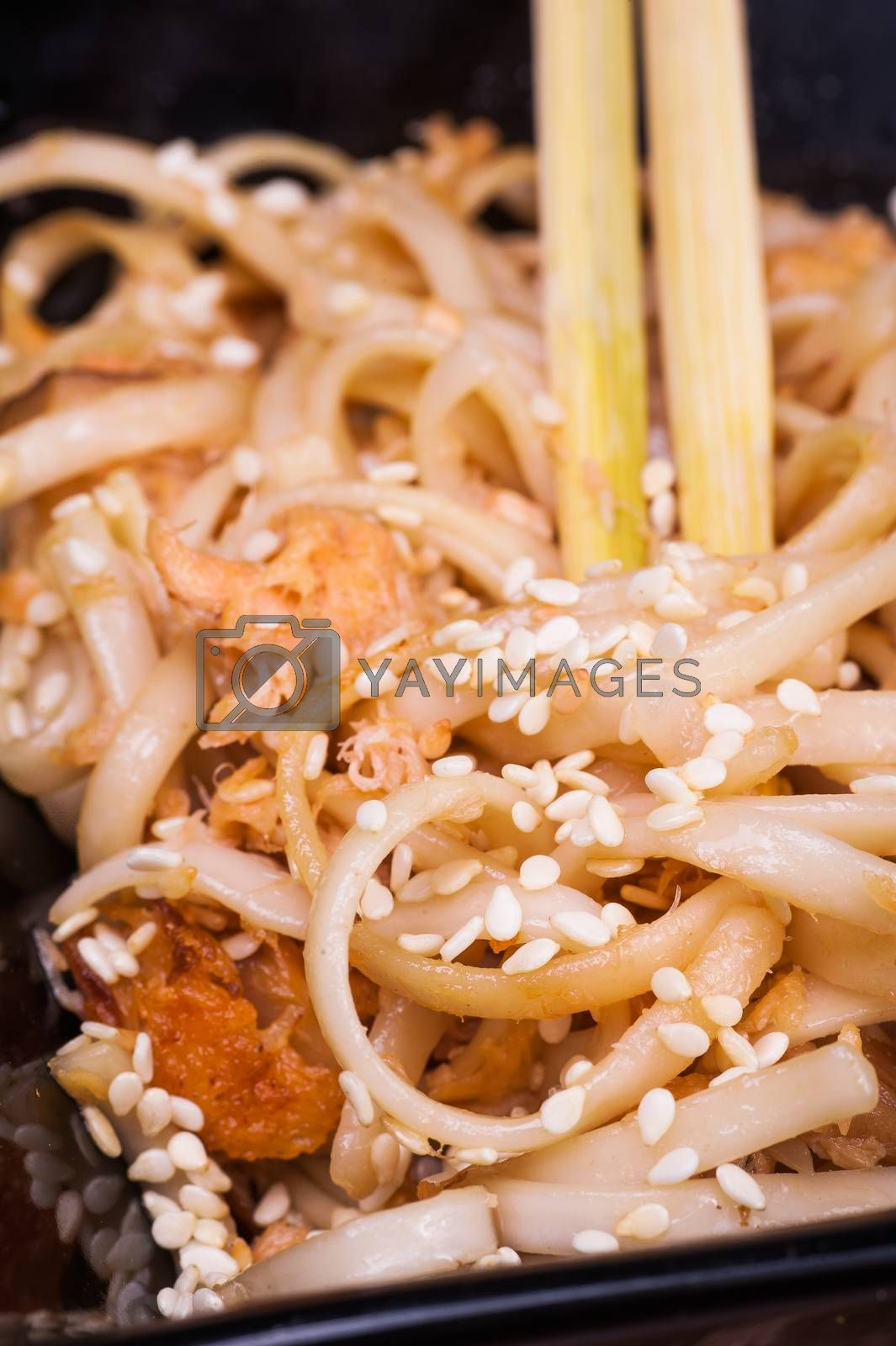asian fried udon noodles on wooden background