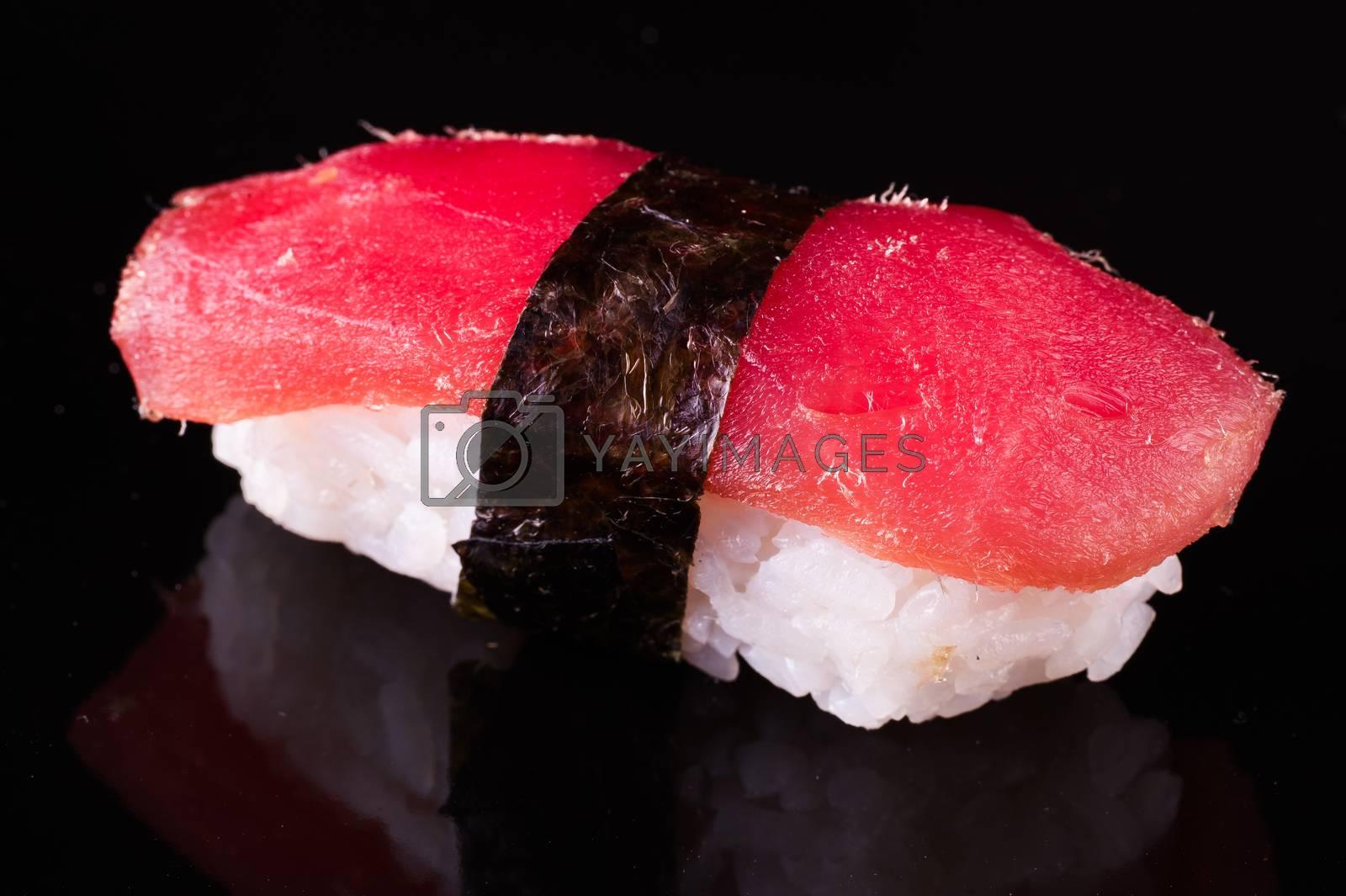 tuna nigiri Maguro isolated on black background