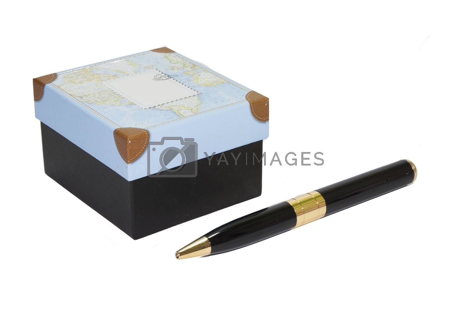 Gift box and pen on white background.