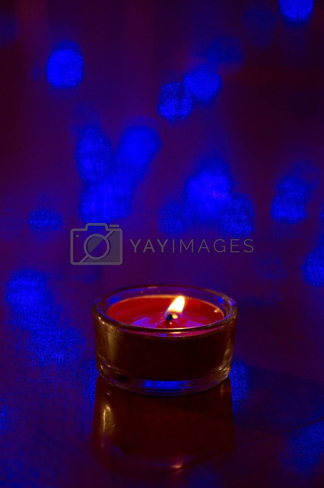 Orange candle on dark  background