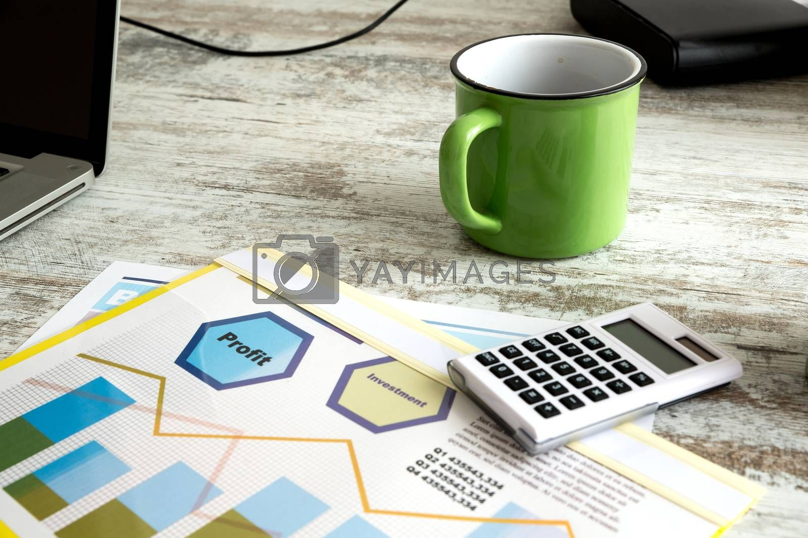 Business analytics with a Data sheet and a cup of coffee.