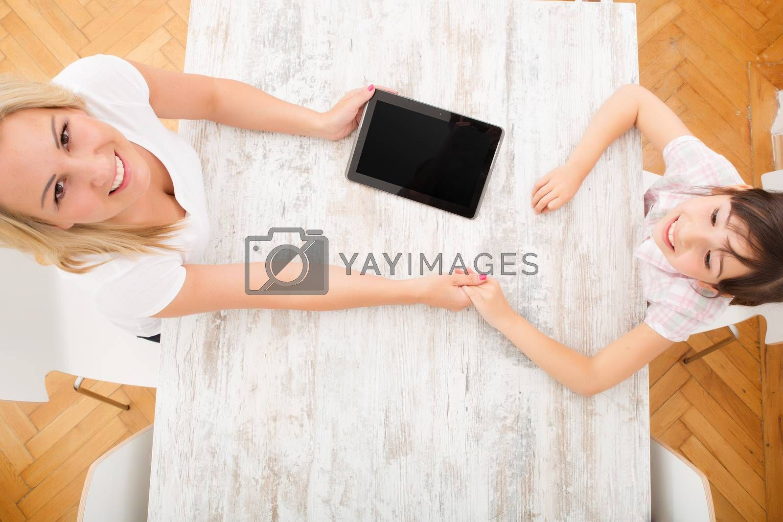 Mother and Daughter with a Tablet PC by Spectral