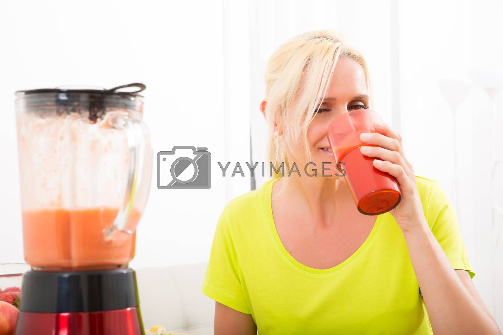 Mature woman enjoying a smoothie by Spectral