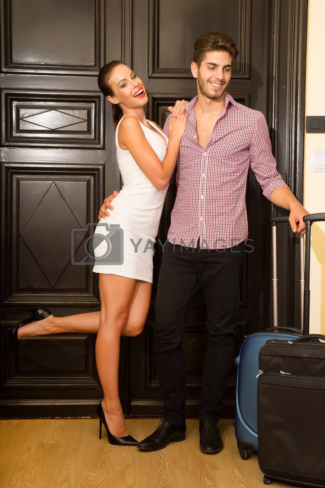 A young couple flirting at the door on their honeymoon