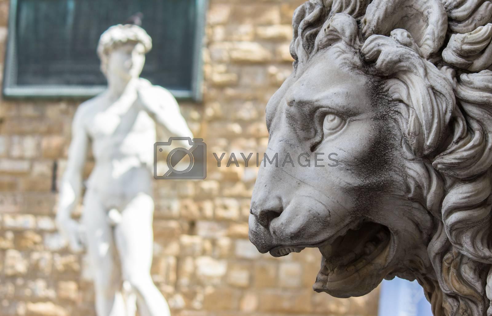 Lion statue stands at the entrance of the Loggia dei Lanzi in Piazza della Signoria in Florence