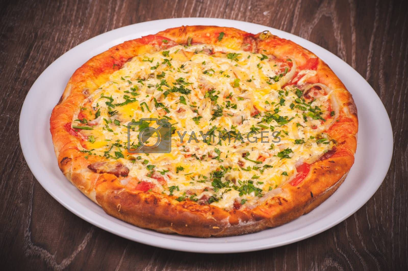 italian pizza with ham on white plate