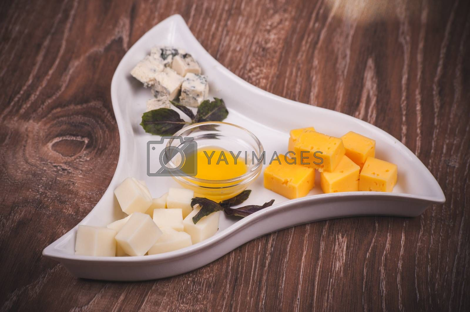 cheese platter with jam on white plate