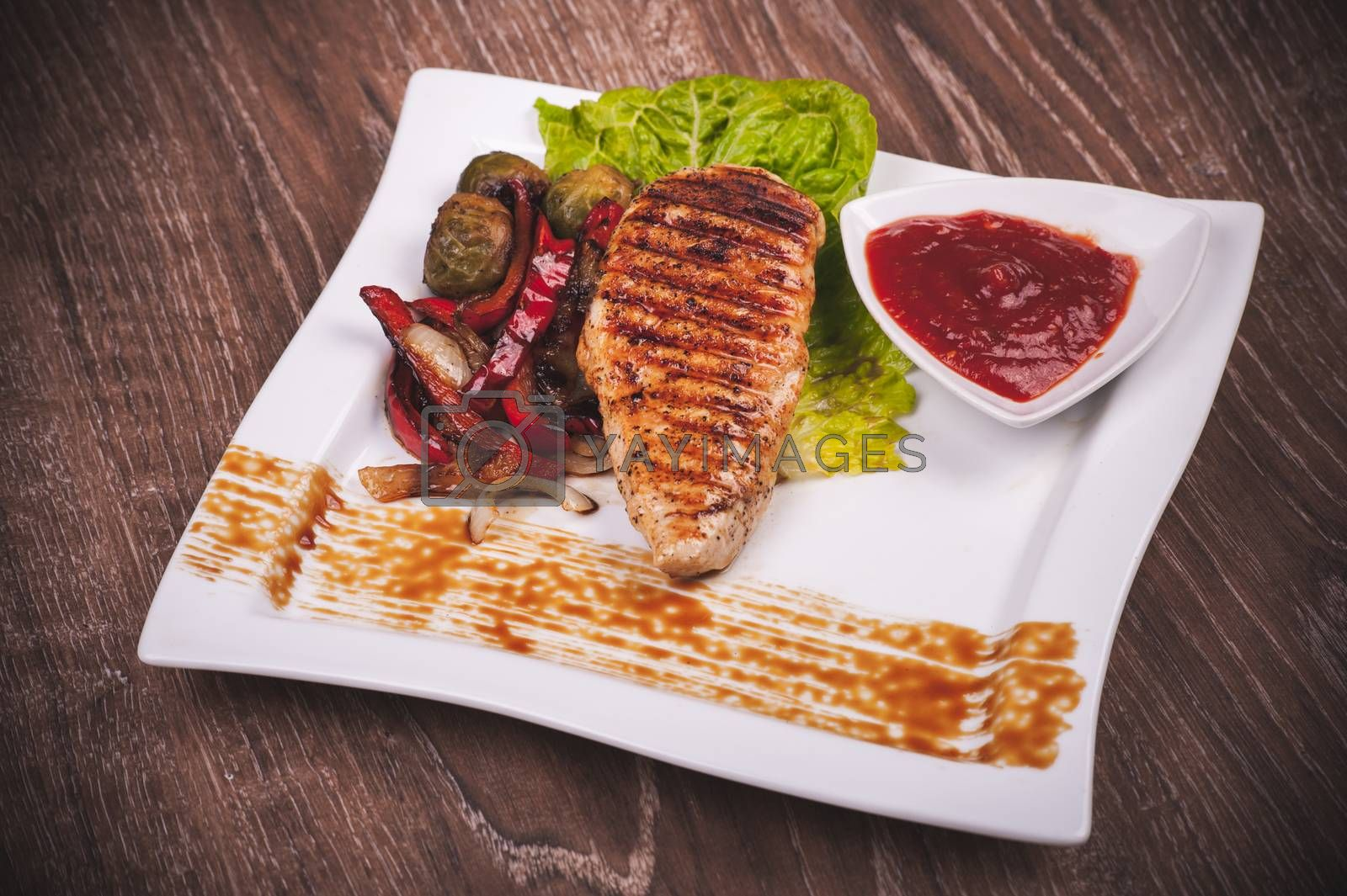 Grilled fillet of chicken with vegetables and sauce