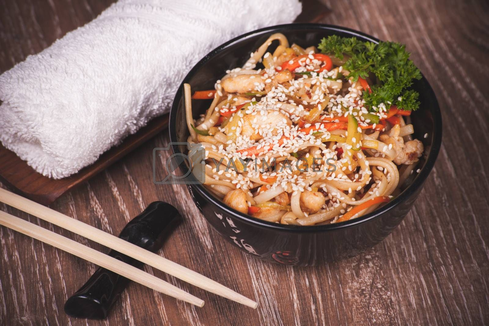 chicken udon noodles in bowl with chopsticks