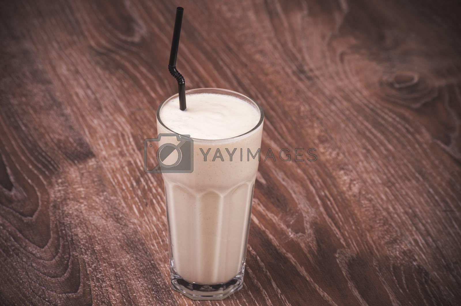 banana milk shake in glass  with straw