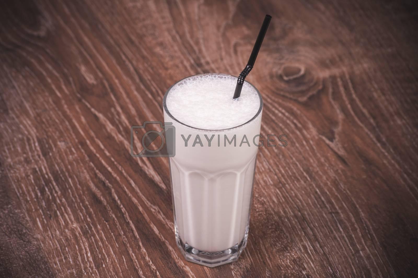 vanilla milk shake with straw  in glass