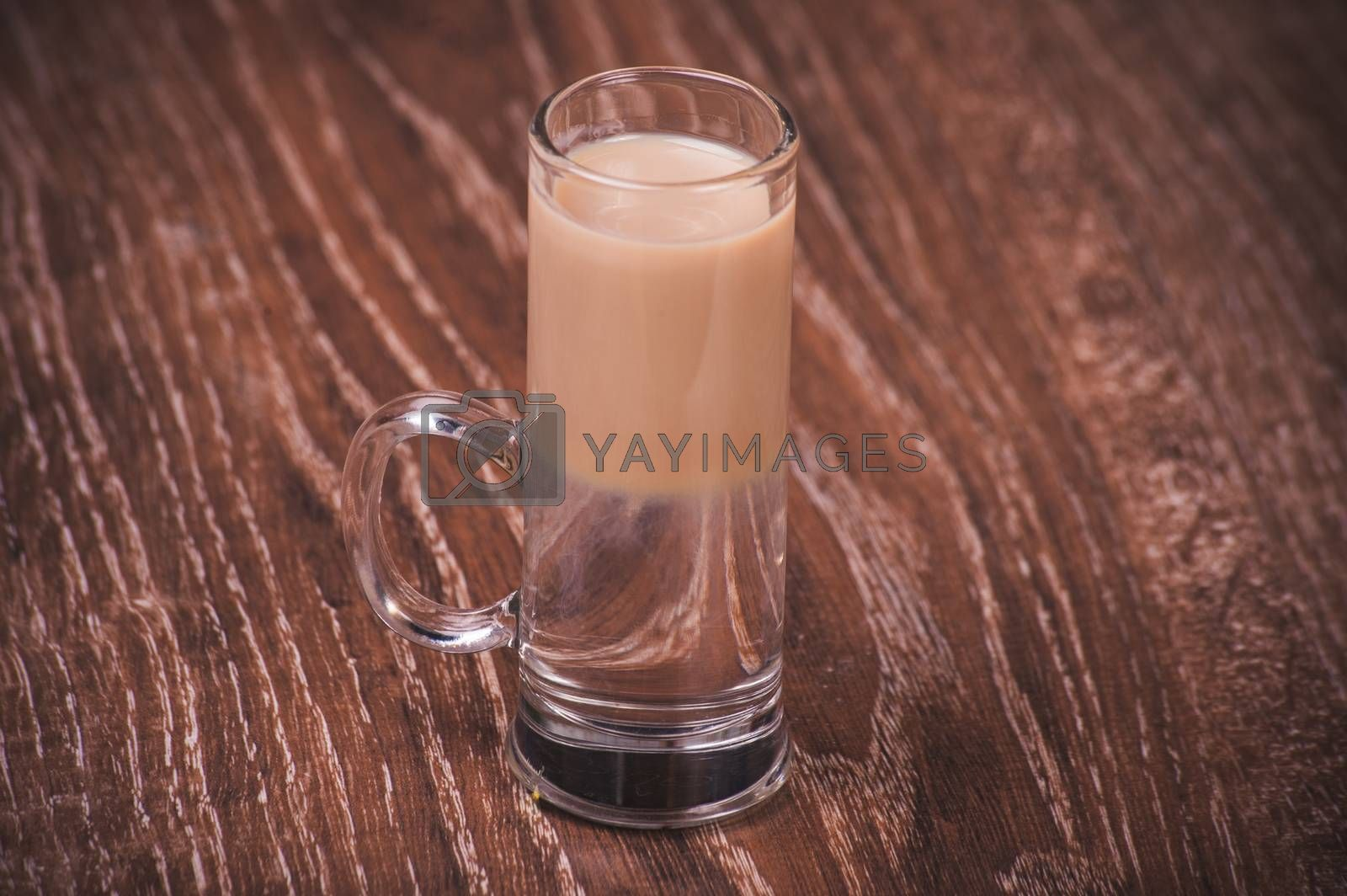 Layered alcohol shot cocktail with baileys and vodka