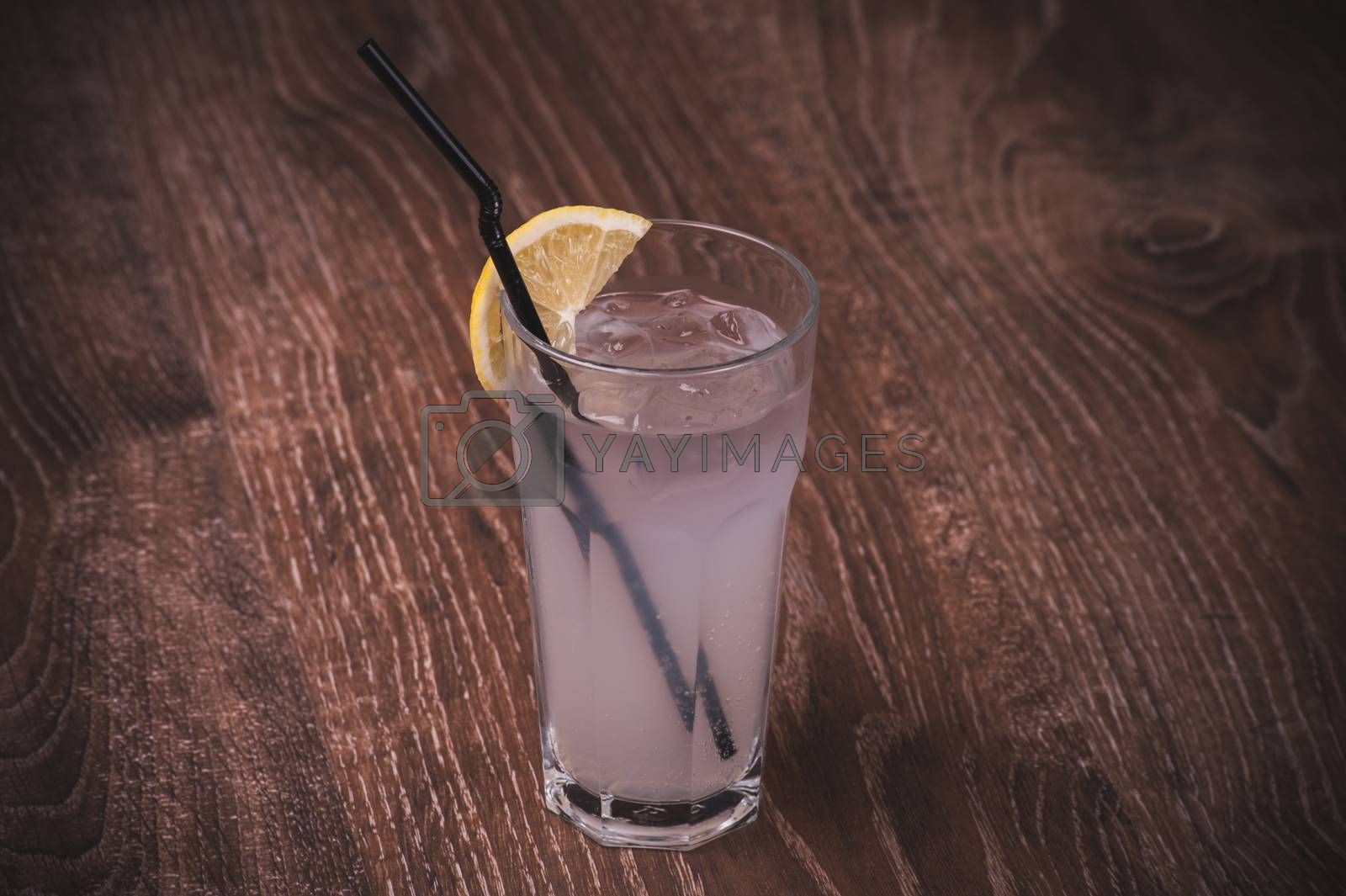 ice cold lemonade with lemon in glass