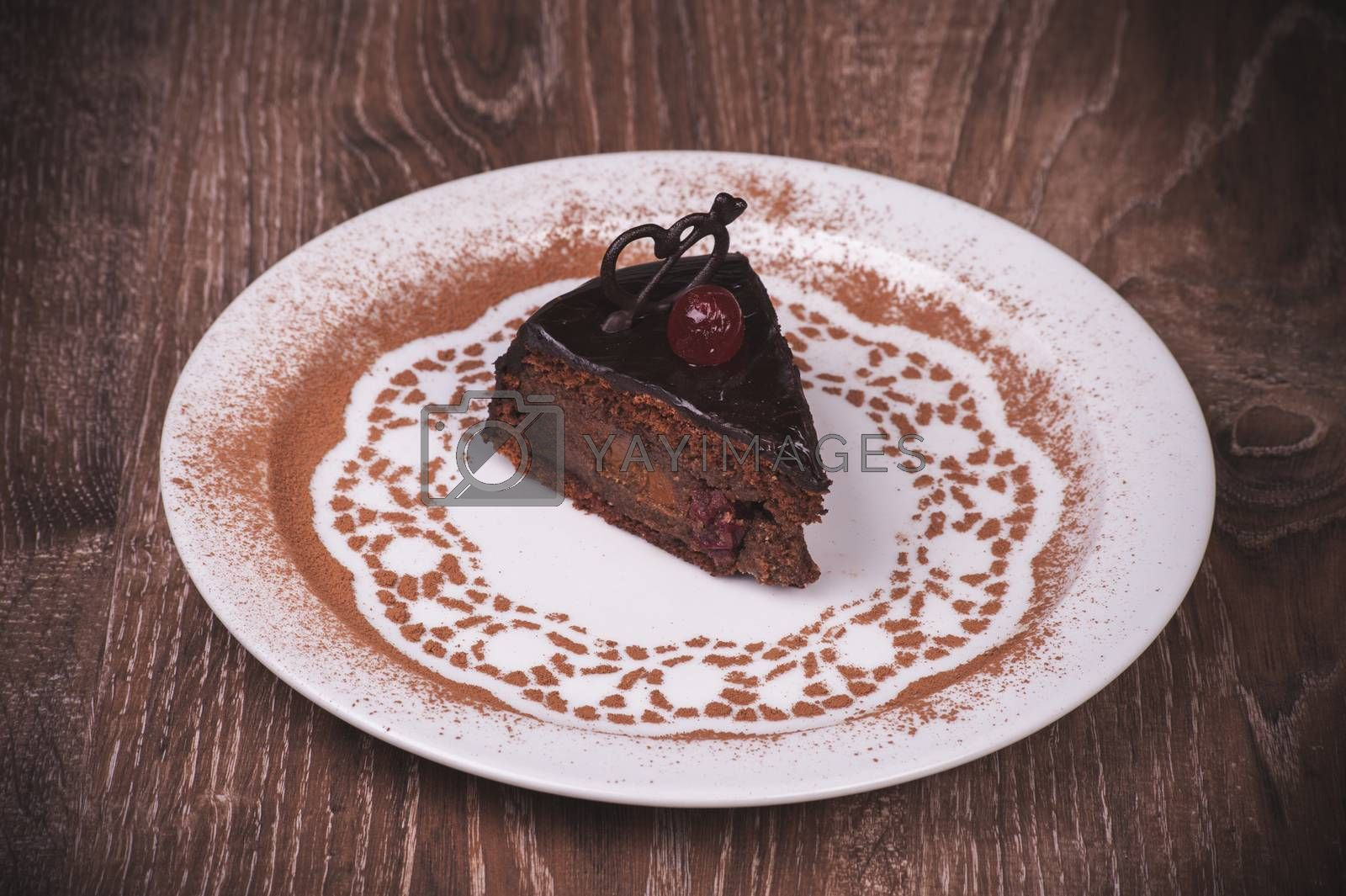 Chocolate and cherry cake slice on white pllate