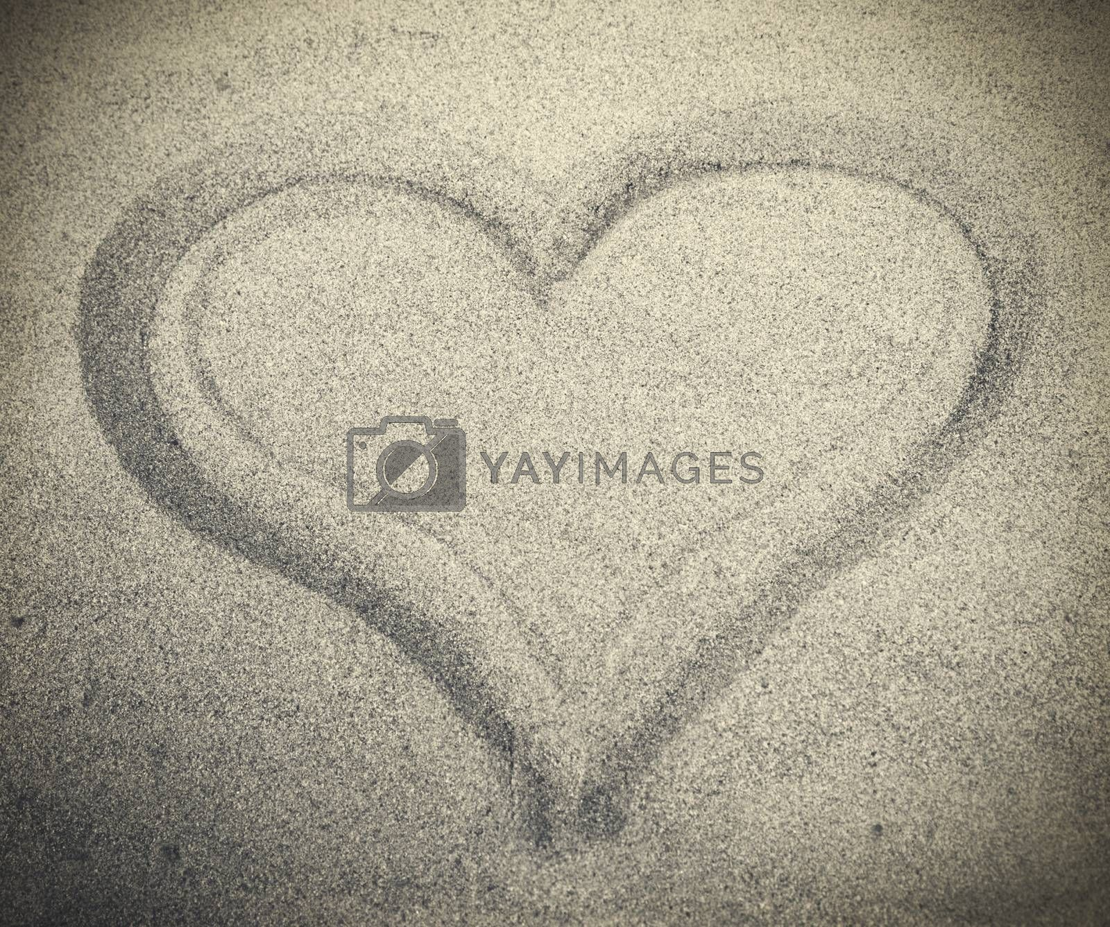 Picture of heart drew on white sand