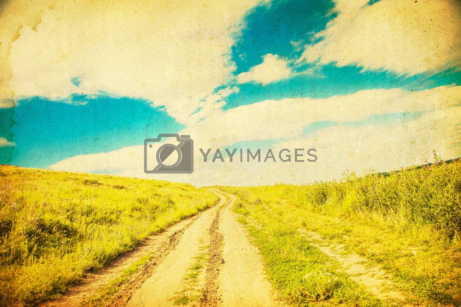 The road through the field at sunset.Grunge and retro style.