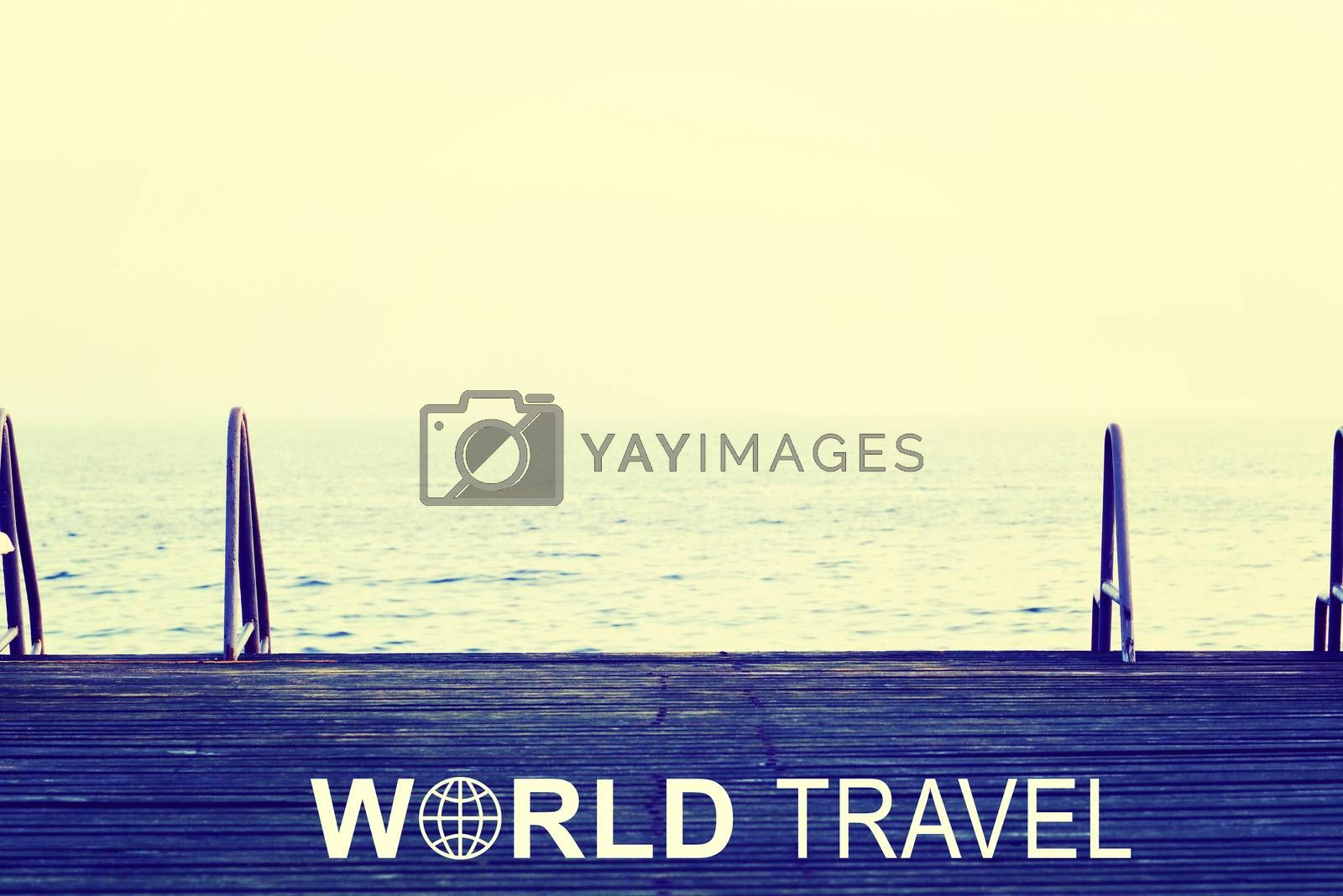 Footbridge witn two gangway ladders at sea, lake or river.. Iinscription World Travel and related symbol