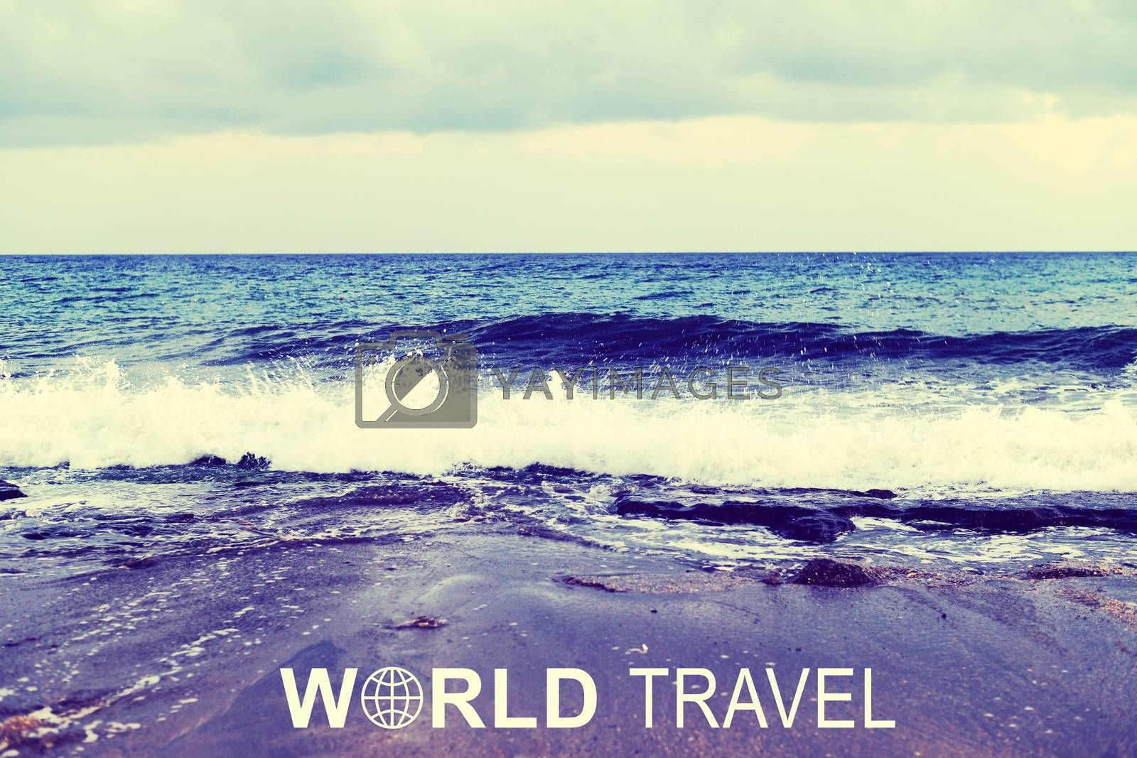 Sea wave rolling ashore. Inscription World Travel and related symbol