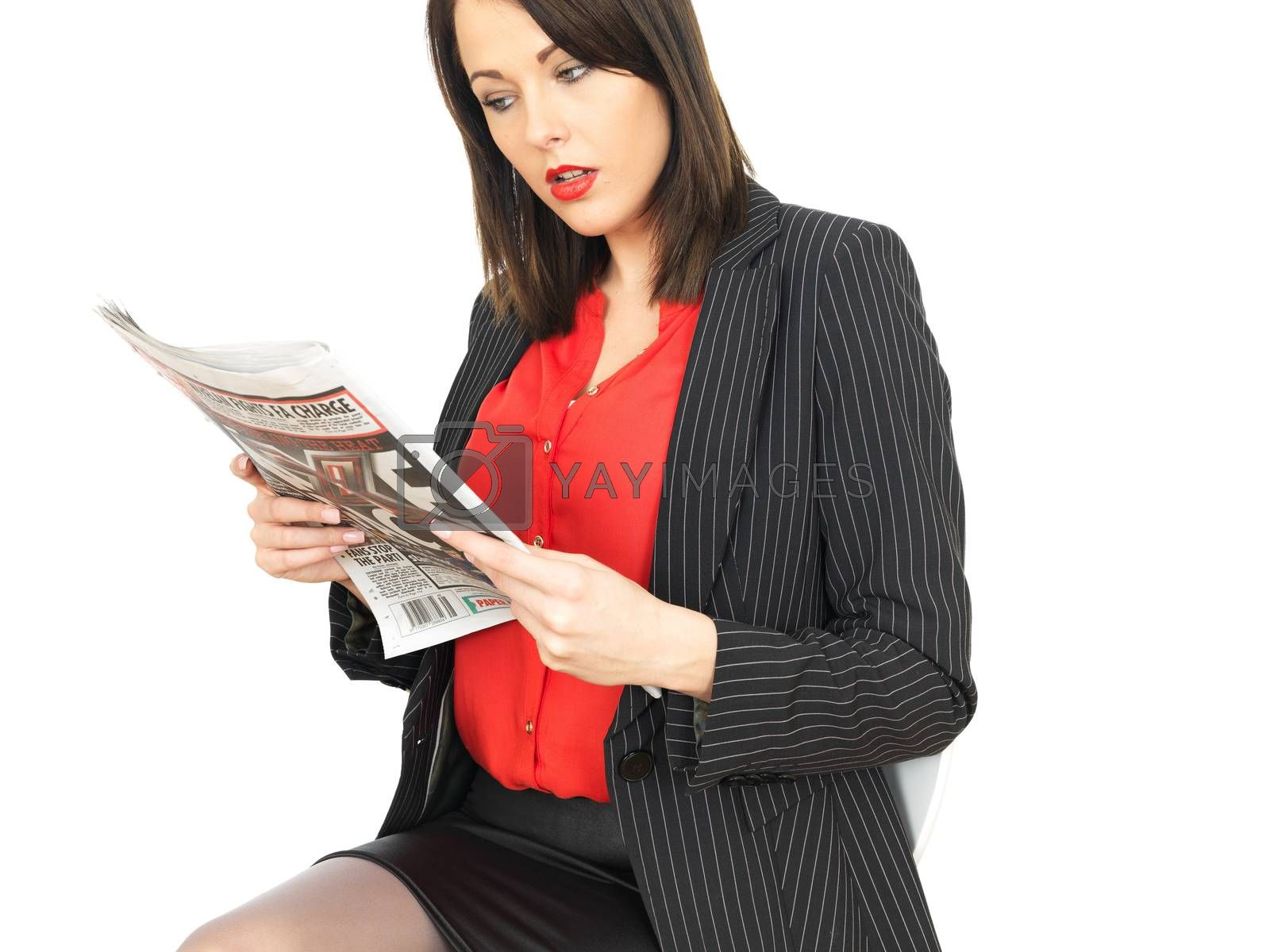 Young Business Woman Reading a Newspaper by Whiteboxmedia