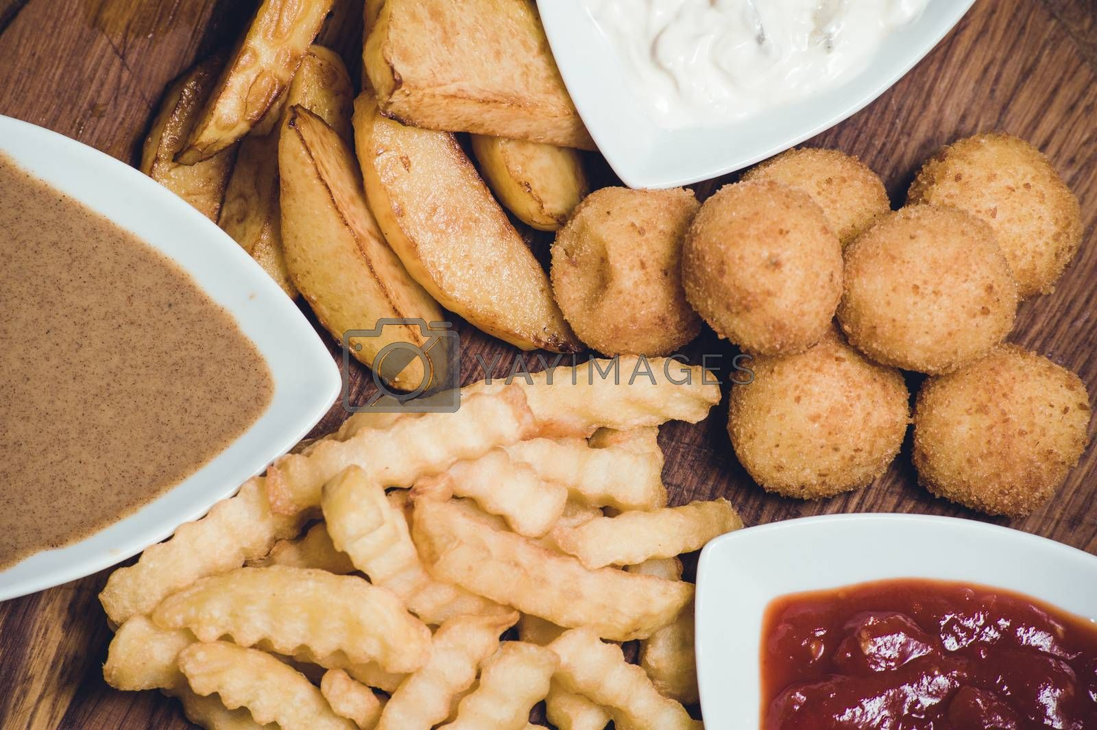 snack potato platter with dips on wooden board