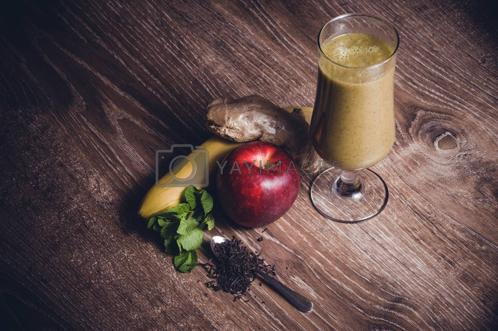 healthy banana and apple smoothie with fruits
