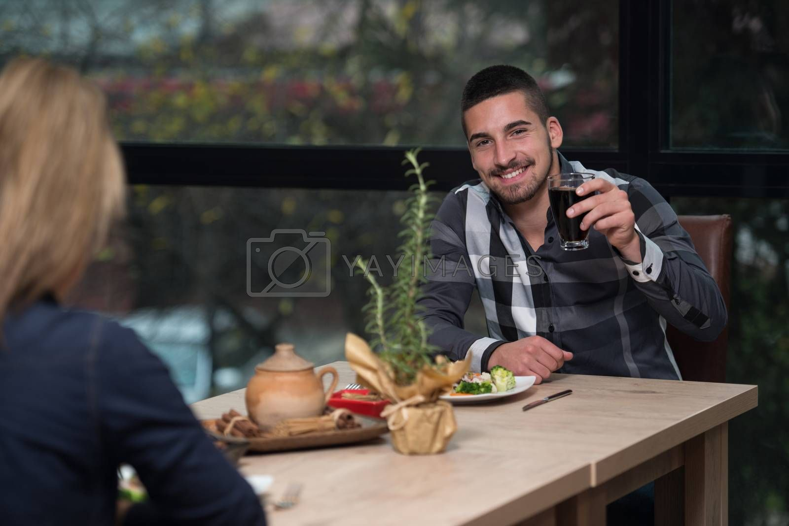 Royalty free image of Couple Enjoying Meal In Restaurant by JalePhoto