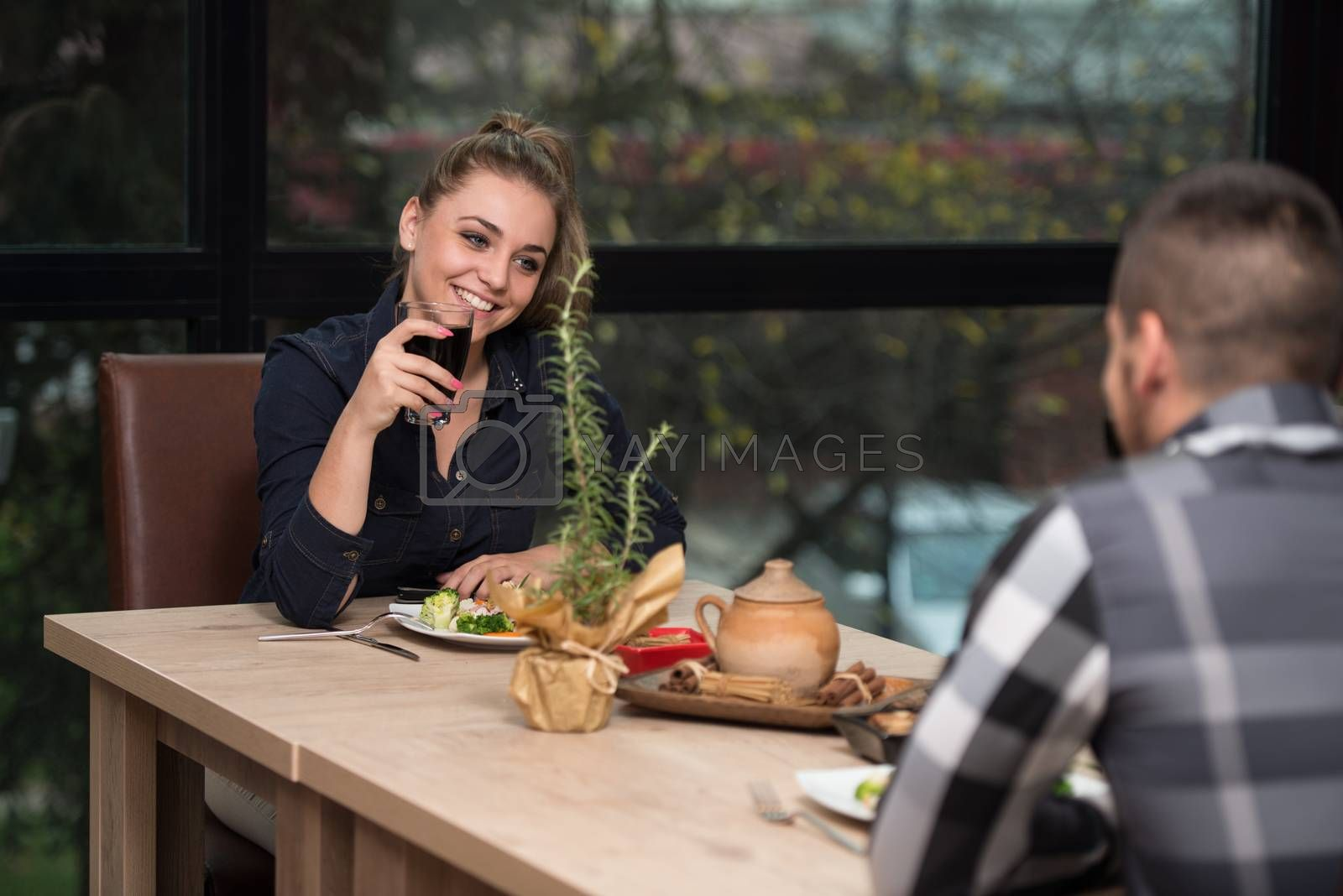Royalty free image of Couple Having Dinner In A Restaurant by JalePhoto
