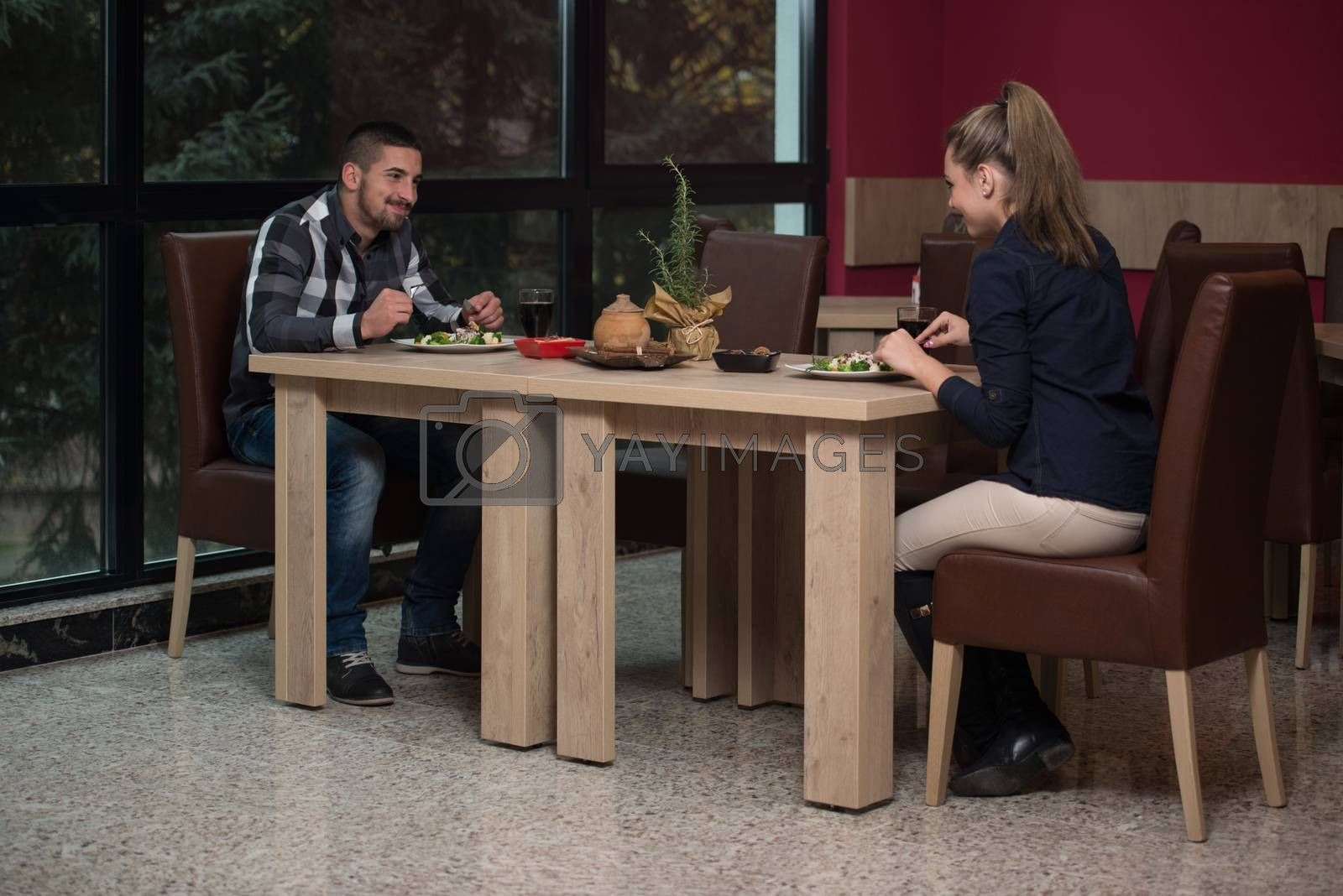 Royalty free image of Handsome Couple Having Lunch by JalePhoto