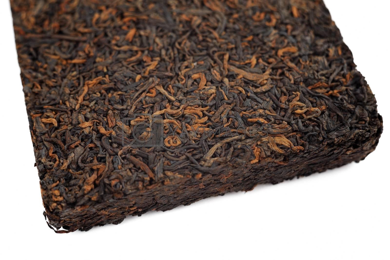 Ripe black puerh brick closeup macro isolated