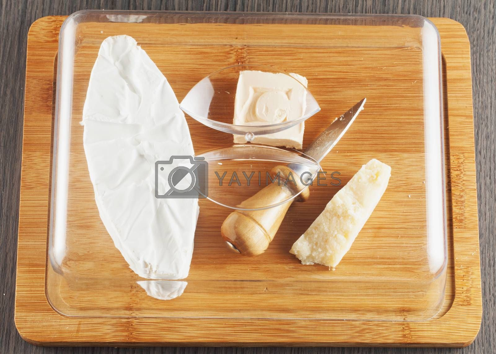 Different types of cheese over chopping board