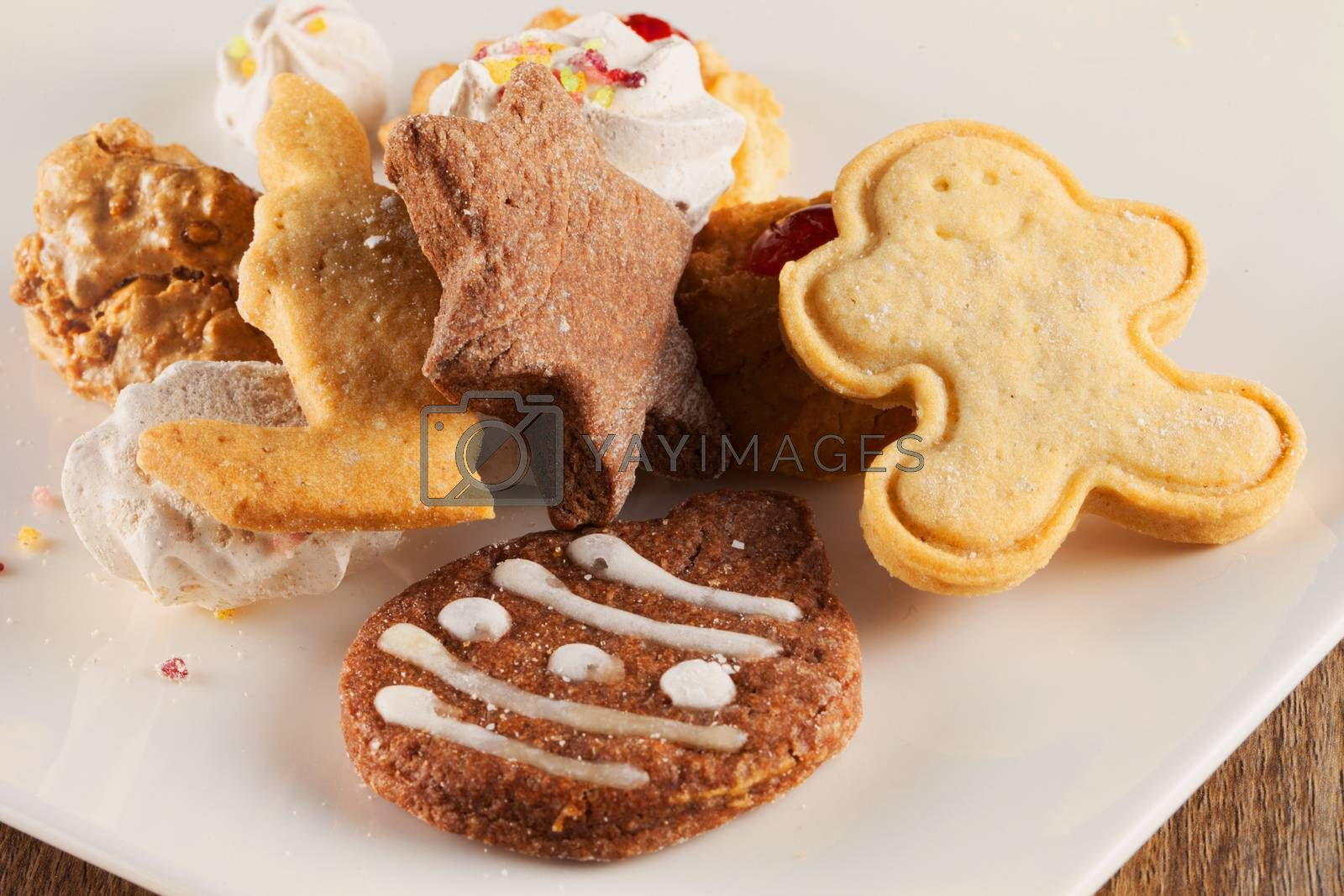 Christmas biscuits over white plate, horizontal image
