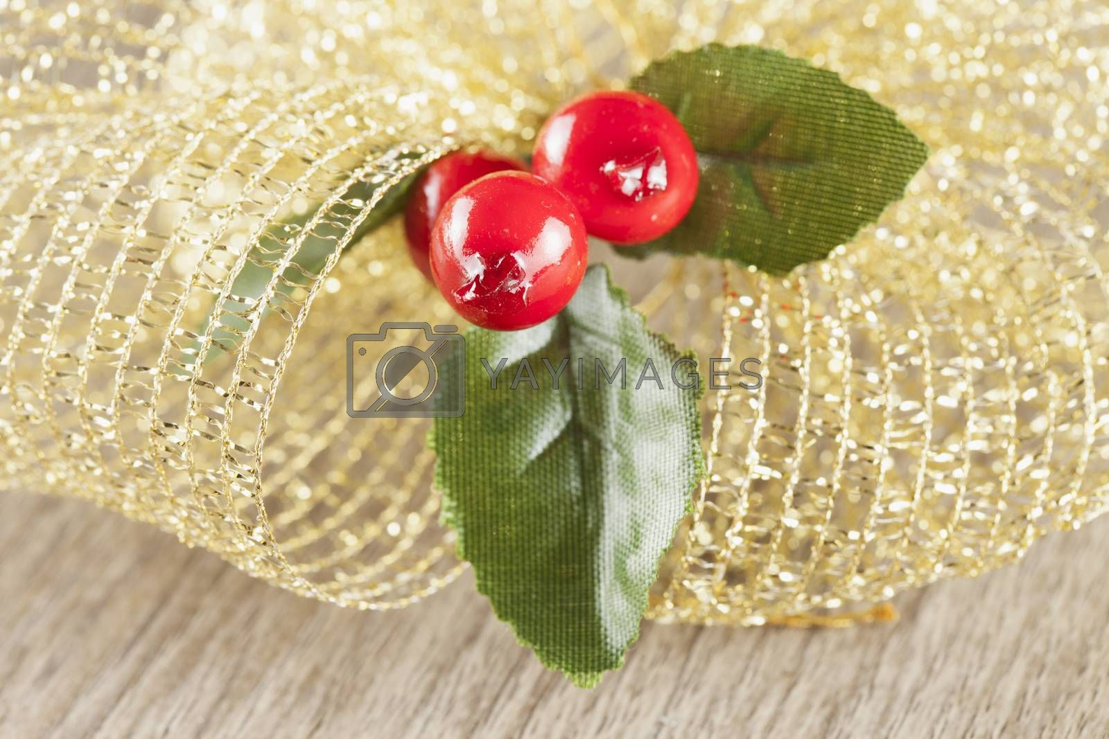 Christmas decoration in close up, over wooden background