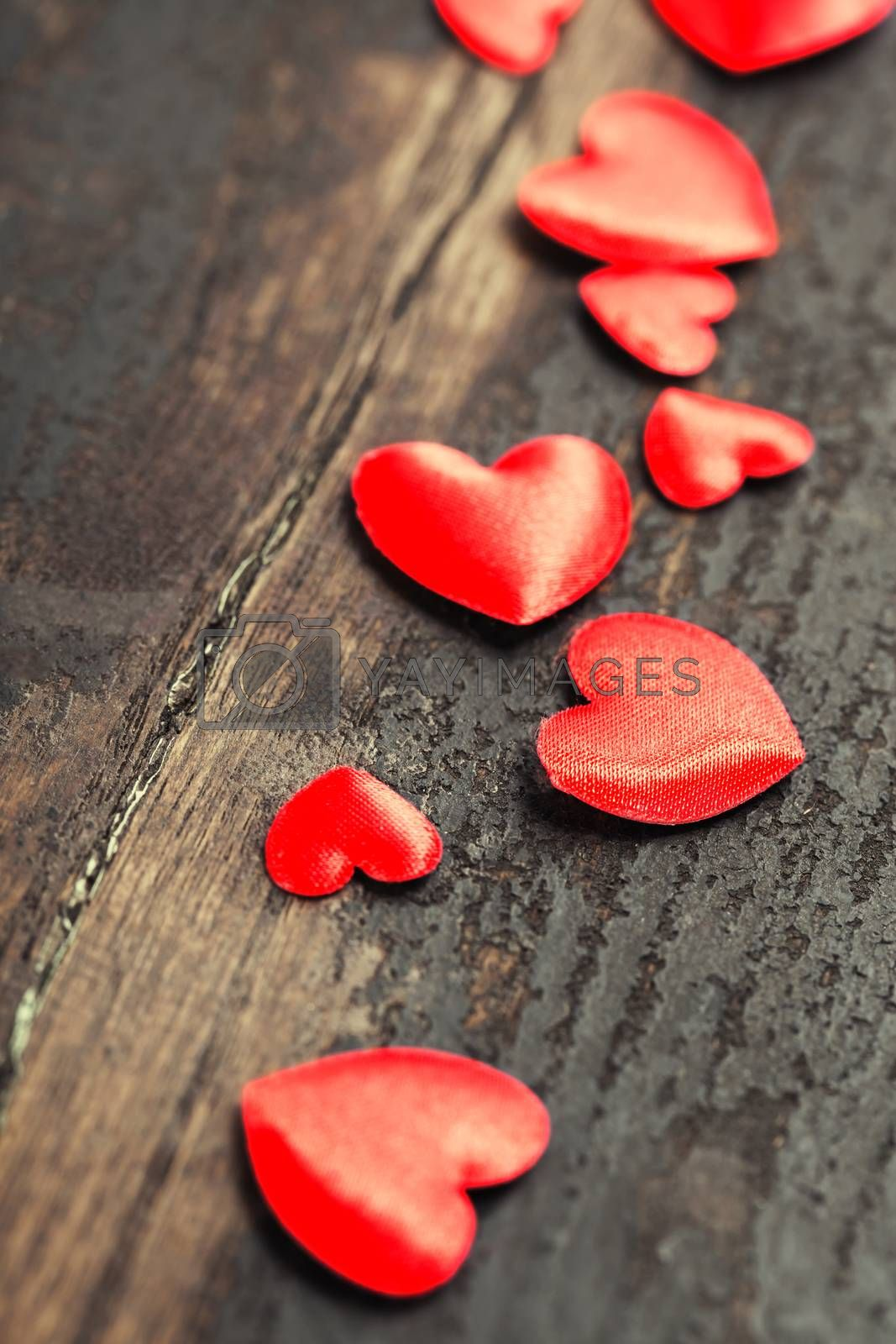 Valentines Day background with hearts on wooden background