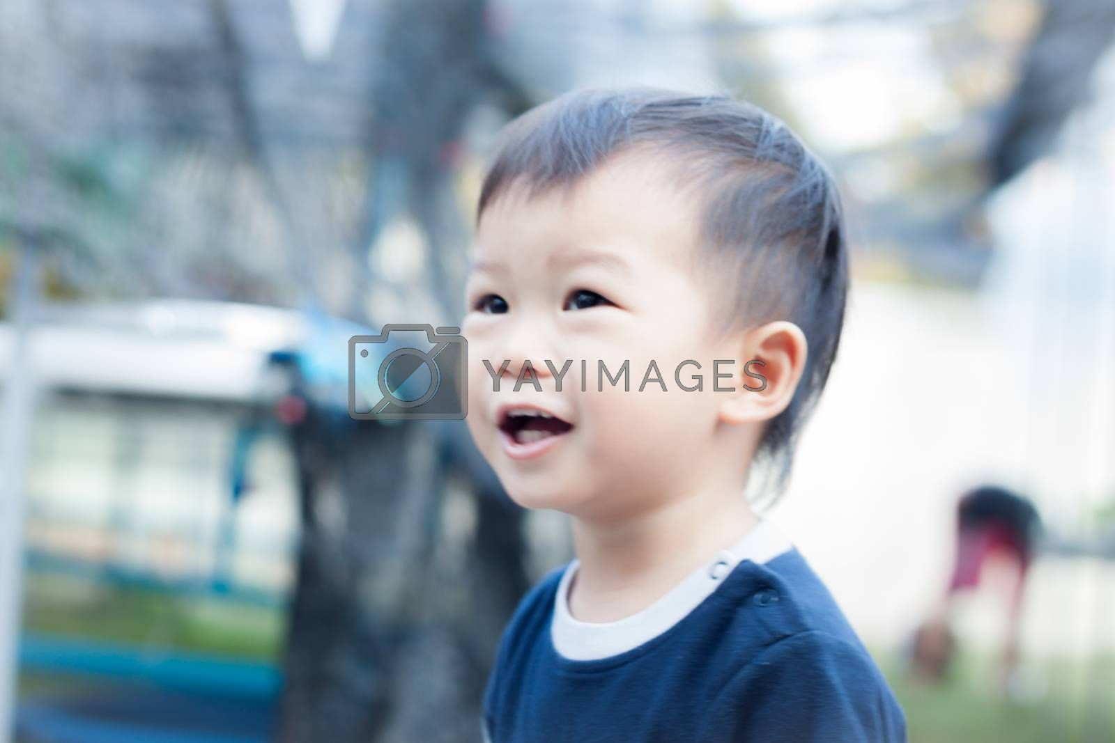 Little asian boy play at playground by punsayaporn