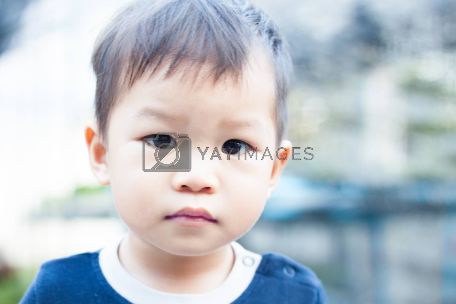 Little asian boy looking at camera  by punsayaporn