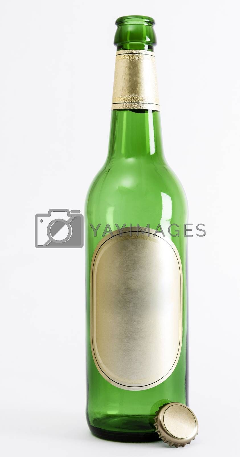empty green beer bottle with crown seal in light background