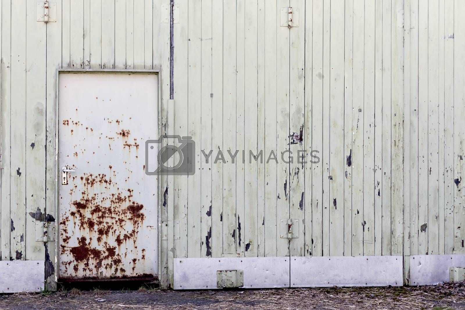old shelter with rotten door. full frame image