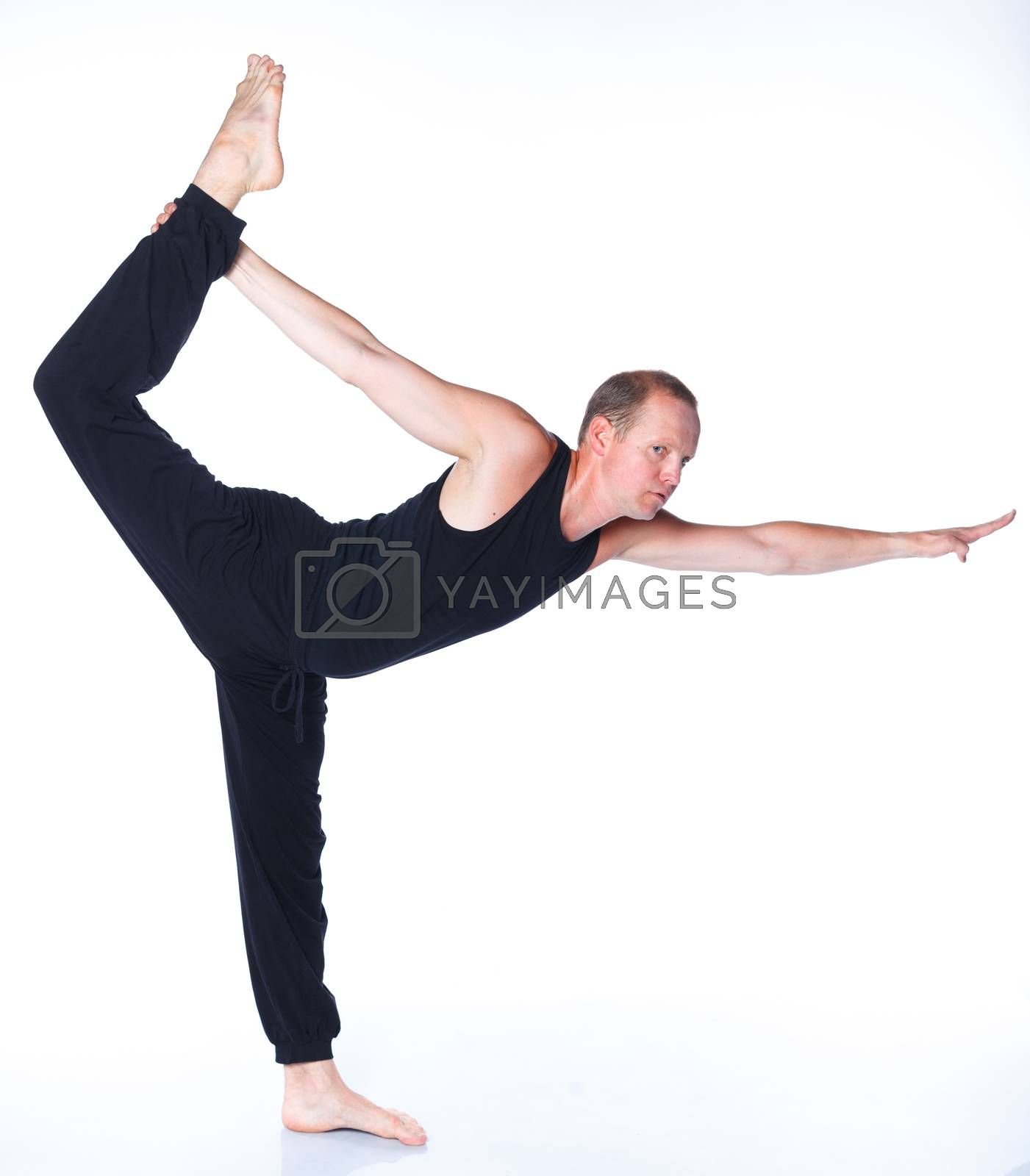 Young and handsome man doing yoga. Isolated on white backgraund