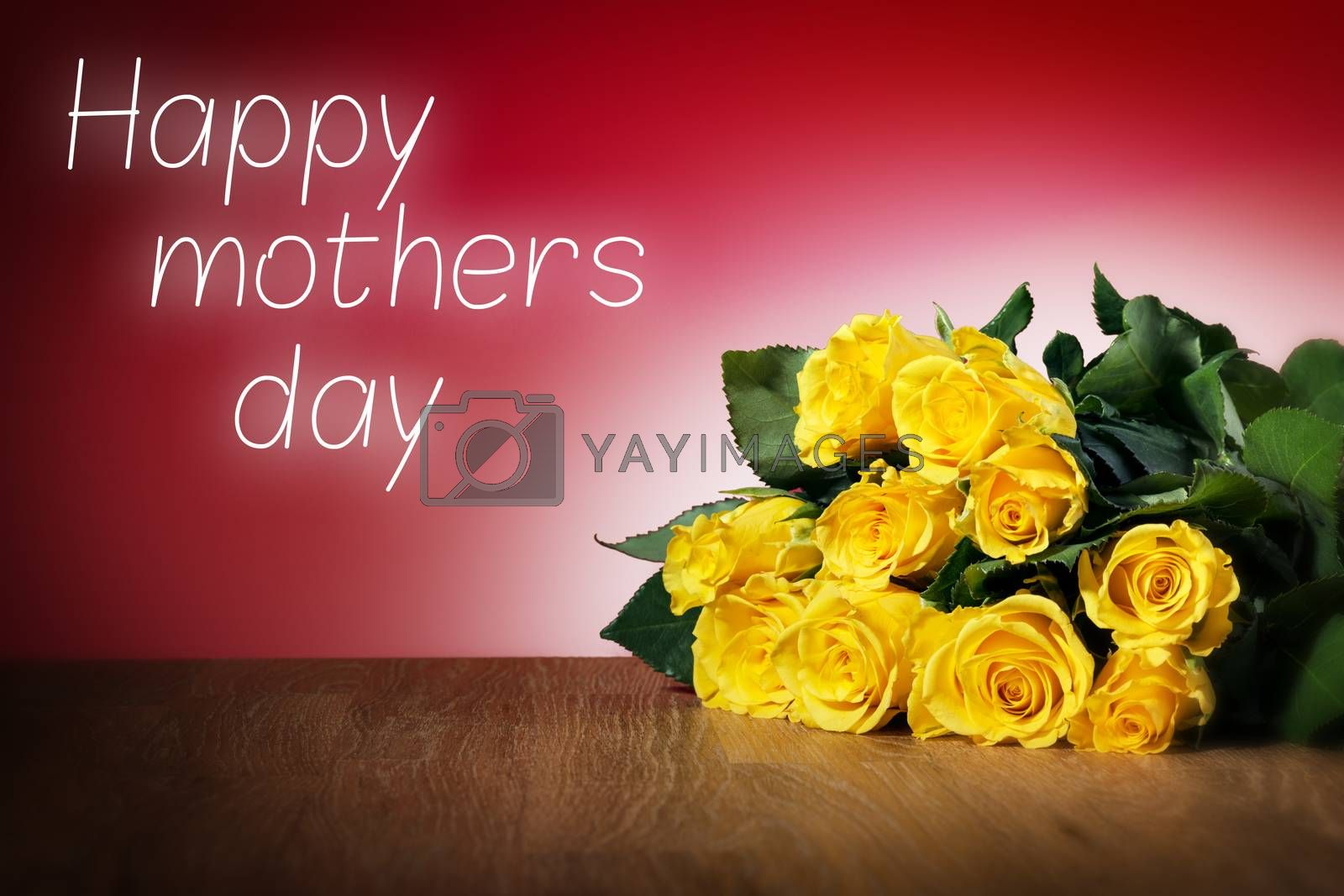 Bunch of yellow roses on a table and with red background, message happy mothers day