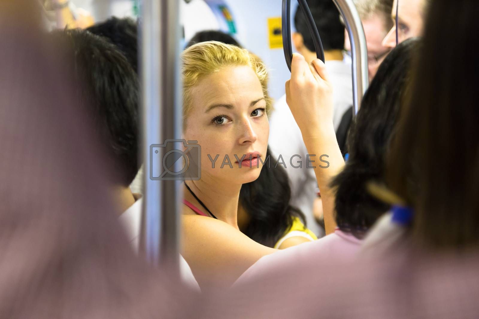 Blonde caucasian lady traveling by public transport.