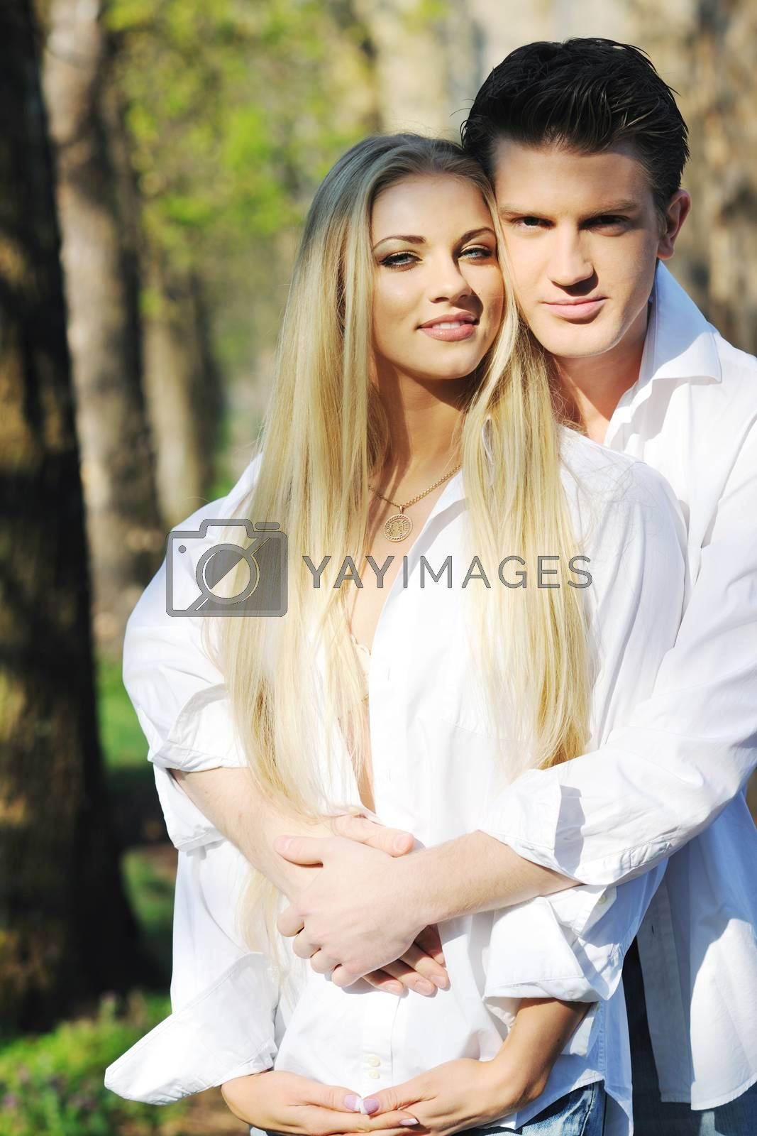 happy young romantic couple in love dance outdoor at spring season on early mornig with beautiful light