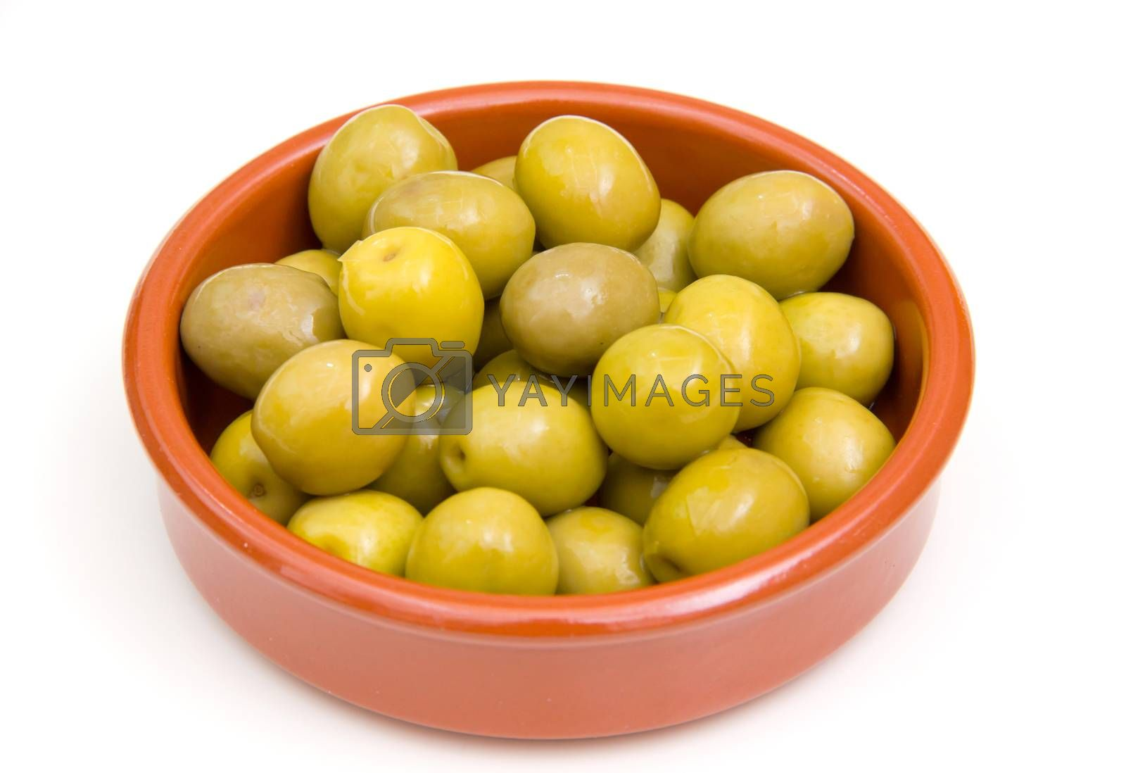 Olives on rustic bowl on white background